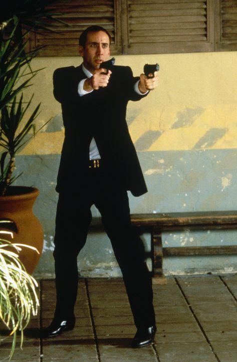 Nachdem sich der FBI-Agent Sean Archer (Nicolas Cage) das Gesicht seines Urfeindes Castor Troy hat implantieren lassen, beginnt für ihn ein apokaly... - Bildquelle: Touchstone Pictures