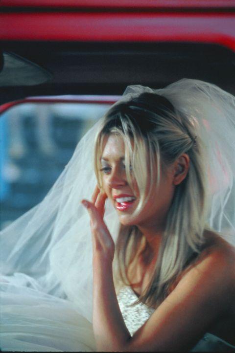 Julianne (Tara Reid) ist mit ihrem derzeitigen Leben vollkommen unzufrieden. Um ihren herrischen Eltern zu entkommen, heiratet sie Hals über Kopf M... - Bildquelle: Splendid Pictures