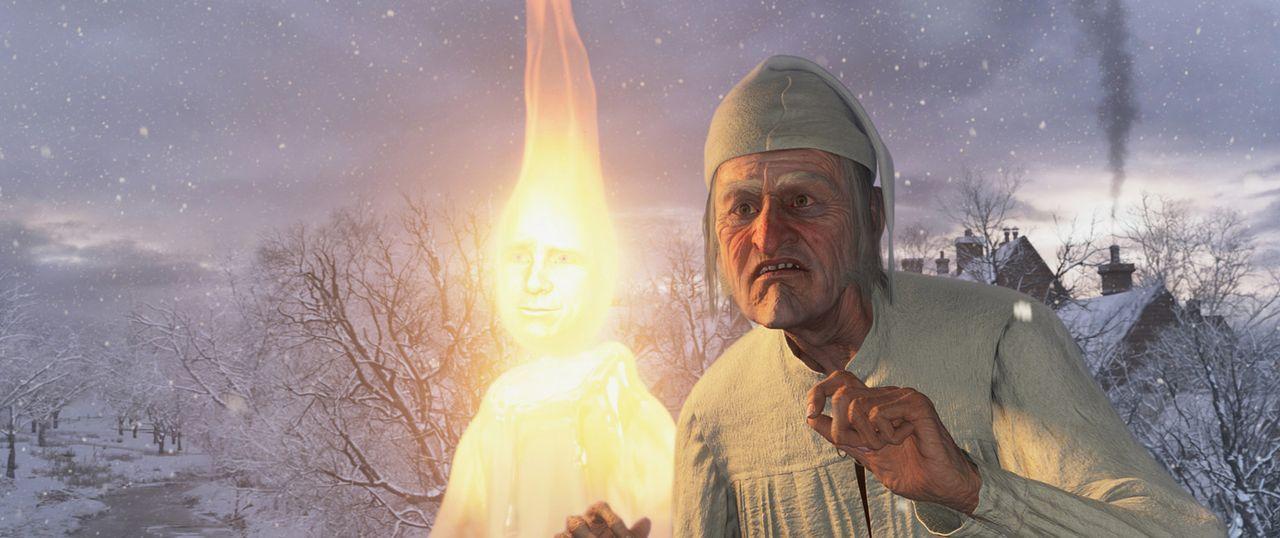 Der Geist der vergangenen Weihnacht (Jim Carrey, l.) nimmt Ebenezer Scrooge (Jim Carrey, r.) mit auf eine unvergessliche Reise ... - Bildquelle: Walt Disney Pictures/Imagemovers Digital, LLC.