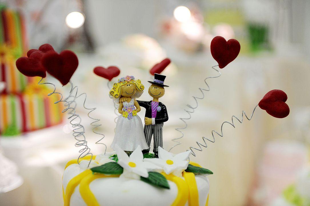 Hochzeitstorte-Figuren-AFP - Bildquelle: AFP