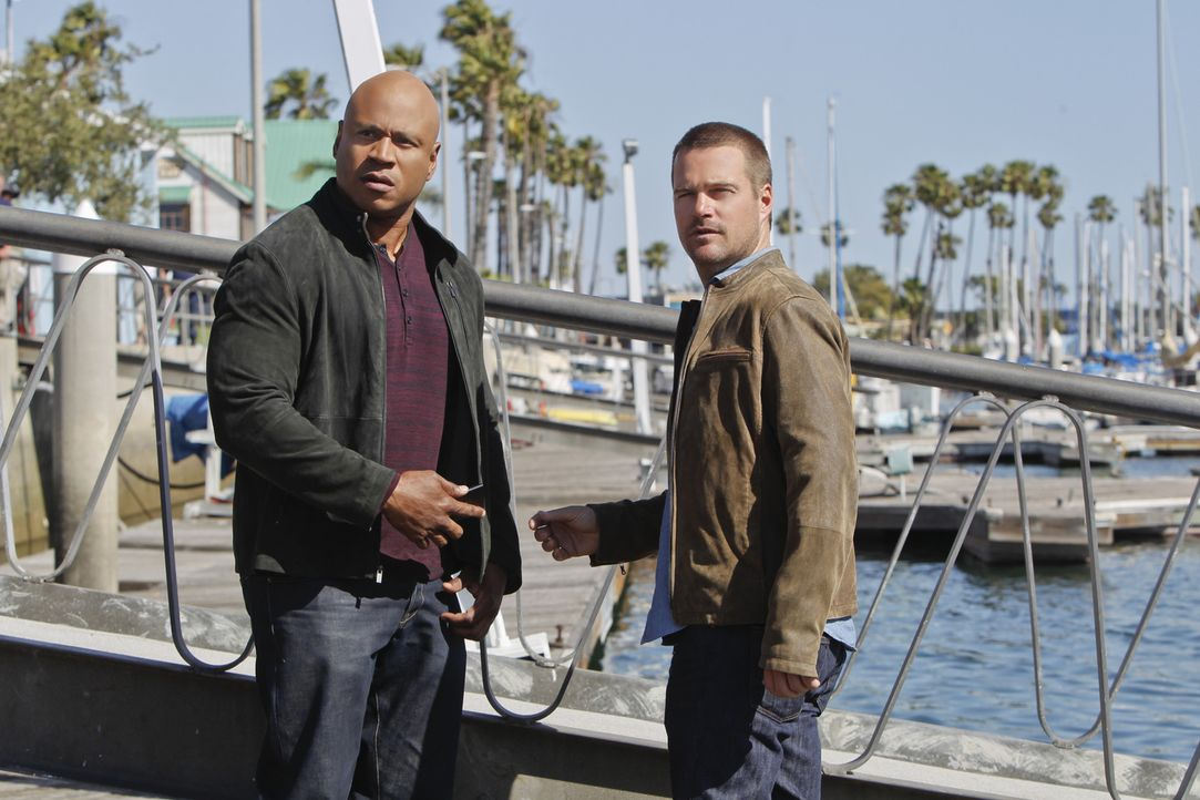 Als Sam (LL Cool J, l.) verhaftet wird, da er angeblich eine junge Frau umgebracht haben soll, schwört Callen (Chris O'Donnell, r.), dass er alles d... - Bildquelle: 2014 CBS Broadcasting, Inc. All Rights Reserved.