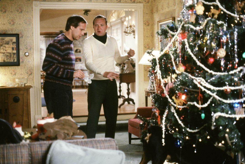Clark (Chevy Chase, l.); Eddie (Randy Quaid, r.) - Bildquelle: 1989 Warner Bros. Entertainment Inc. All rights reserved.