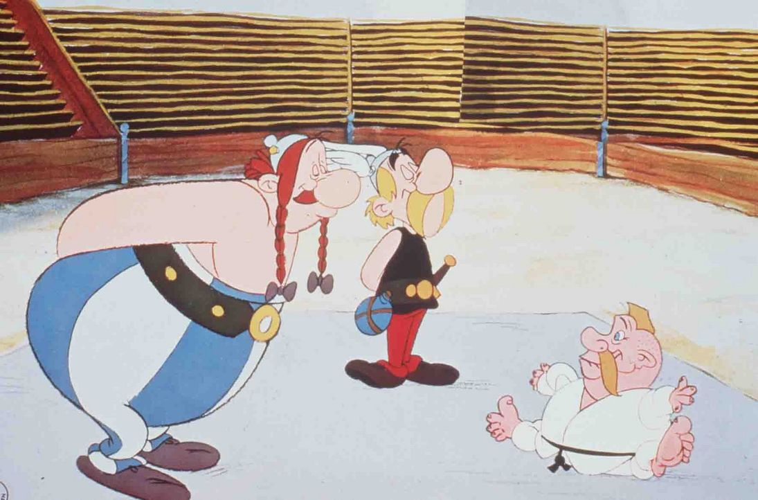 Cäsar stellt Asterix (M.) und Obelix (l.) zwölf Prüfungen, und eine davon ist, gegen den germanischen Judomeister (r.) zu kämpfen. Ob sie eine Chanc... - Bildquelle: Jugendfilm-Verleih GmbH