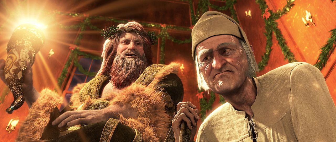 Nachdem Ebenezer Scrooge (Jim Carrey, r) Besuch von den Geistern der vergangenen, gegenwärtigen (Jim Carrey, l.) und zukünftigen Weihnacht bekomme... - Bildquelle: Walt Disney Pictures/Imagemovers Digital, LLC.